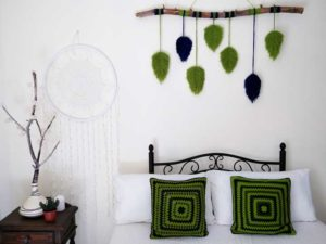 crochet pillow in boho style interior
